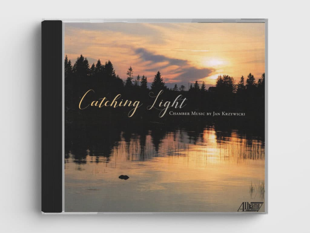 CD cover of Catching Light CD, shows sunset over pond with silhouettes of trees